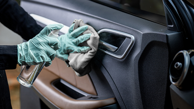 Clean and disinfect surfaces in vehicle interiors